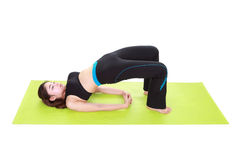 Young woman doing yoga exercise with yoga mat Stock Photography
