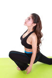 Young woman doing yoga exercise with yoga mat Royalty Free Stock Photo