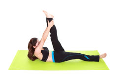 Young woman doing yoga exercise with yoga mat Royalty Free Stock Image