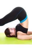 Young woman doing yoga exercise with yoga mat Stock Image