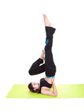Young woman doing yoga exercise with yoga mat Stock Photos