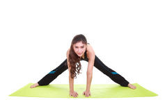Young woman doing yoga exercise with yoga mat Stock Photo