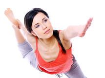 Young woman doing yoga exercises. Young and beautiful woman doing yoga exercises isolated over white background Royalty Free Stock Photo