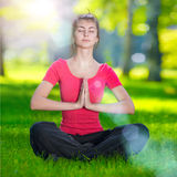Young woman doing yoga exercises Stock Photos