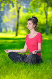 Young woman doing yoga exercises Royalty Free Stock Image