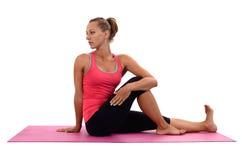 Young woman doing yoga Stock Photos