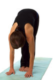 Young woman doing yoga exercises. An image of a young woman doing yoga exercises Royalty Free Stock Photos