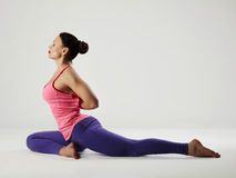 Young woman doing yoga exercises.healthy fit sport girl. Stretching Stock Image