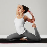 Young woman doing yoga exercises.healthy fit sport girl Stock Image
