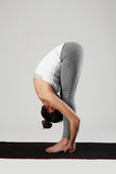 Young woman doing yoga exercises.healthy fit sport girl. Stretching Royalty Free Stock Images