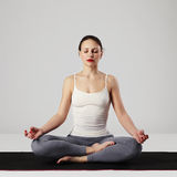 Young woman doing yoga exercises.healthy Royalty Free Stock Images