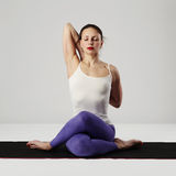 Young woman doing yoga exercises.healthy Stock Photos