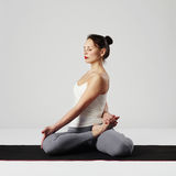 Young woman doing yoga exercises.healthy. Sport girl Stock Photo