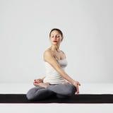 Young woman doing yoga exercises.healthy Stock Photo
