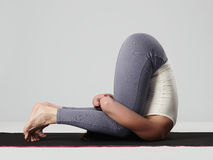 Young woman doing yoga exercises.healthy sport girl Royalty Free Stock Photos