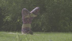 Young woman doing yoga exercises stock footage