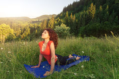 Young woman doing yoga exercises in the nature Royalty Free Stock Images