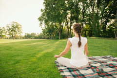 Young woman doing yoga exercises in the nature Stock Photography