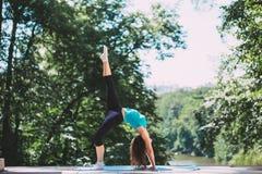 Young Woman doing Yoga Exercises Outdoor Stock Photos