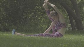 Young woman doing yoga exercises stock video