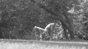 Young woman doing yoga exercises in the park stock video footage