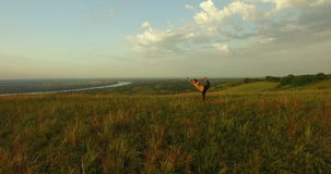 Young woman doing yoga in the field. Fruska gora, Novi Sad, Serbia. Woman doing yoga in the field. Fruska gora, Novi Sad, Serbia stock footage