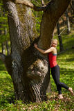 Young woman doing yoga in a forest Royalty Free Stock Image