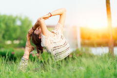 Young woman doing yoga in group Stock Photography