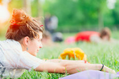Young woman doing yoga in group Royalty Free Stock Photo