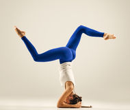 Young woman doing yoga Headstand Pose Royalty Free Stock Image