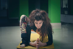 Young woman doing yoga indoor Stock Image
