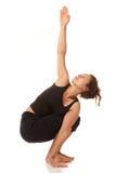 Young woman doing yoga indoors Stock Photo