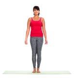 Young woman doing yoga. Stock Photos