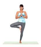 Young woman doing yoga. Stock Photo