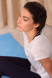 Young Woman Doing Yoga Meditating Relaxing Exercise at home.Healthy Lifestyle. female practicing meditation on the floor, morning Royalty Free Stock Images