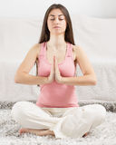 Young Woman Doing Yoga Meditating Relaxing Exercise Royalty Free Stock Photography