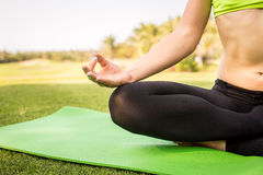 Young woman doing yoga in morning park Stock Images
