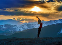 Young woman doing yoga in the mountains Royalty Free Stock Image