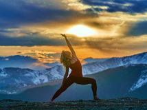 Young woman doing yoga in the mountains Royalty Free Stock Photography