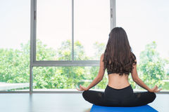 Young woman doing yoga moves or meditating Royalty Free Stock Photos