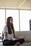 Young woman doing yoga in office royalty free stock photo