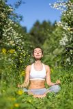 Young woman doing yoga outdoor Stock Photos
