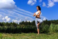 Young woman doing yoga outdoor Stock Image