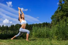 Young woman doing yoga outdoor Royalty Free Stock Photos