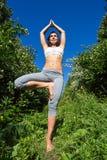 Young woman doing yoga outdoor Stock Photos