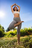 Young woman doing yoga outdoor Royalty Free Stock Image