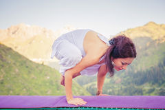 Young woman doing yoga outdoor at mountain Stock Photography