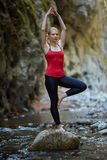 Young woman doing yoga outdoor Royalty Free Stock Photo