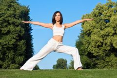 Young woman doing yoga outside Royalty Free Stock Photography