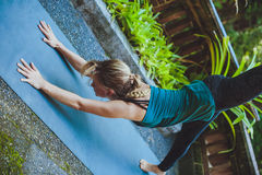 Young woman doing yoga outside in natural environment Royalty Free Stock Image